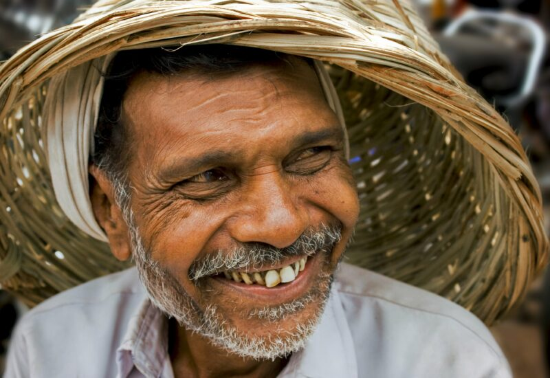 © Indianeye, Dreamstime.com lizensiert für a&e erlebnisreisen__7488389__A smiling rural man with using a basket as cap for protection from sunlight